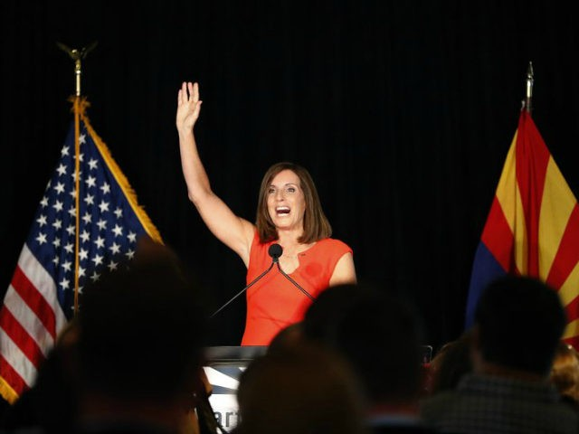 U.S. Senate candidate and U.S. Rep. Martha McSally, R-Ariz., celebrates her primary election victory, Tuesday, Aug. 28, 2018, in Tempe, Ariz. McSally will face U.S. Rep. Krysten Sinema, D-Ariz., in the November election as they seek the seat of retiring U.S. Sen. Jeff Flake, R-Ariz. (AP Photo/Matt York)
