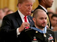 WASHINGTON, DC - OCTOBER 01: U.S. President Donald Trump awards the Medal of Honor to Ronald Shurer October 01, 2018 in Washington, DC. Shurer, a Special Forces combat medic, and his team of commandos were attacked by an enemy force of more than 200 fighters in April of 2008 in …