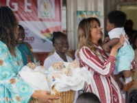 US First Lady Melania Trump holds a baby during a visit to the Greater Accra Regional Hospital in Accra, on October 2, 2018, as she begins her week long trip to Africa to promote her 'Be Best' campaign. (Photo by SAUL LOEB / AFP) (Photo credit should read SAUL LOEB/AFP/Getty …