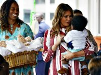 First lady Melania Trump holds a baby as she visits Greater Accra Regional Hospital in Accra, Ghana, Tuesday, Oct. 2, 2018. The first lady is visiting Africa on her first big solo international trip, aiming to make child well-being the focus of a five-day, four-country tour.