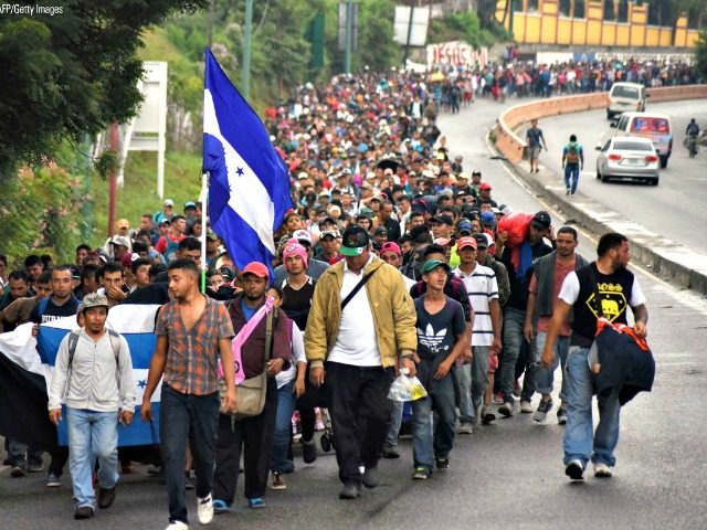 Honduran migrants take part in a caravan heading toward the U.S. in Chiquimula, Guatemala on October 17. Currently, the group is making its way through Guatemala and it is unclear whether it will be allowed to enter Mexico.