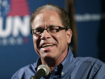 In this May 8, 2018 file photo Republican Senate candidate Mike Braun thanks supporters after winning the republican primary in Whitestown, Ind. Braun rails against foreign outsourcing on the campaign trail, even as his own company continues to sell its trademarked brand of auto accessories, many of which are made …