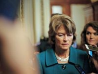 File - In this Oct. 4, 2018 file photo, Sen. Lisa Murkowski, R-Alaska, pauses while speakings to members of the media after a vote to advance Brett Kavanaugh's nomination to the Supreme Court, on Capitol Hill. Alaska Republican party leaders plan to consider whether to reprimand Murkowski for opposing Kavanaugh's …