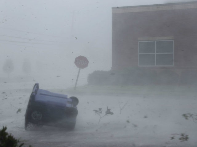 A trash can and debris are blown down a street by Hurricane Michael on October 10, 2018 in Panama City, Florida. The hurricane made landfall on the Florida Panhandle as a category 4 storm. (Photo by Joe Raedle/Getty Images)