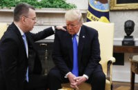 President Donald Trump prays with American pastor Andrew Brunson in the Oval Office of the White House, Saturday October 13, 2018, in Washington. Brunson returned to the U.S. around midday after he was freed Friday, from nearly two years of detention in Turkey.