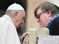 Pope Francis speaks with US documentary filmmaker Michael Moore at the end of the weekly general audience on October 17, 2018 at St. Peter's square in the Vatican. (Photo by Tiziana FABI / AFP) (Photo credit should read TIZIANA FABI/AFP/Getty Images)