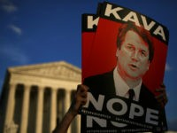 WASHINGTON, DC - OCTOBER 03: Protesters demonstrate against Supreme Court nominee Brett Kavanaugh outside the U.S. Supreme Court October 03, 2018 in Washington, DC. An FBI report on current the current allegations against Kavanaugh is expected by the end of this week, possibly later today.(Photo by Win McNamee/Getty Images)