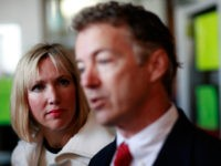 and Paul (R), the Republican candidate for Kentucky's U.S. Senate seat, and his wife, Kelley, talk with reporters after casting their ballots November 2, 2010 in Bowling Green, Kentucky. Paul is running against Democratic candidate Jack Conway. (Photo by Tom Pennington/Getty Images)