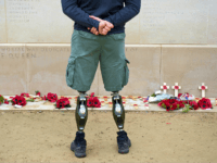 A member of the armed forces with prosthetic legs pays his respects at the Armed Forces Memorial in the National Memorial Arboretum on Armistice Day near Lichfield, Staffordshire, central England, on November 11, 2014. In services around the country tributes were paid to the millions of British servicemen and women …