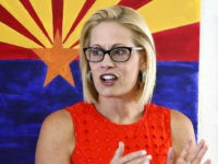 Rep. Kyrsten Sinema, D-Ariz., talks to campaign volunteers at a Democratic campaign office on primary election day Tuesday, Aug. 28, 2018, in Phoenix. Sinema is seeking the current U.S. Senate seat occupied by outgoing Republican Sen. Jeff Flake, and will face the Republican primary winner of the race between Rep. …