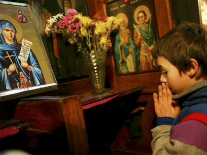 BUCHAREST, ROMANIA - DECEMBER 05: A homelss street child prays at an Orthodox church December 5, 2006 in Bucharest, Romania. Romania, a country of over 21 million people that is set to join the European Union on the first of the year, still struggles with widespread poverty. Approximately 25% of …