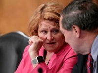 Sen. Heidi Heitkamp, D-N.D., left, and Sen. Joe Donnelly, D-Ind., listen as the Senate Banking Committee holds a hearing on U.S. economic sanctions against Russia and whether the actions are effective, on Capitol Hill in Washington, Tuesday, Aug. 21, 2018. (AP Photo/J. Scott Applewhite)