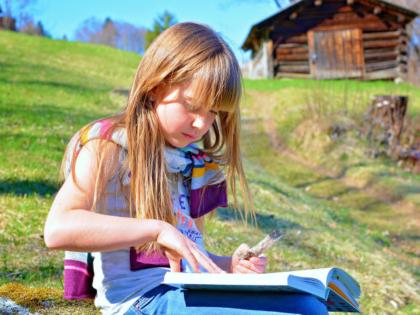 Slovene child reading a faerie tale