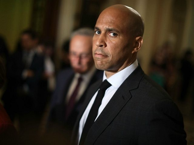 WASHINGTON, DC - JULY 10: Sen. Cory Booker (D-NJ) talks with reporters following the weekly Democratic policy luncheon meeting at the U.S. Capitol July 10, 2018 in Washington, DC. Democrats are facing an uphill struggle to reject President Donald Trump's nominee to the Supreme Court, Judge Brett Kavanaugh. (Photo by …