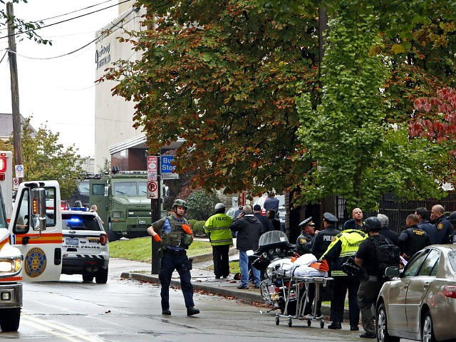First responders surround the Tree of Life Synagogue where a shooter opened fire Saturday, Oct. 27, 2018. (AP Photo/Gene J. Puskar)