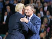President Donald Trump, left, on stage with Republican gubernatorial candidate Secretary of State Kris Kobach, right, during a campaign rally at Kansas Expocentre, Saturday, Oct. 6, 2018 in Topeka, Kan.