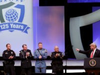 President Donald Trump, far right, recognizes the Target Police officer of the year finalists, from left, Officer Taylor S. Rust of the Plano, Texas, Patrol Officer Mark A. Dallas of the Dixon, Illinois, Washington State Patrol Trooper Nathaniel Dawson and Sergeant Luis Celis of the Doral, Florida during the International …