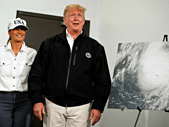 First lady Melania Trump looks on as President Donald Trump reacts to a question about Sen. Elizabeth Warren from a reporter during a briefing with state and local officials on the response to Hurricane Michael, Monday, Oct. 15, 2018, Macon, Ga
