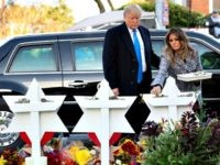US President Donald Trump and First Lady Melania Trump place stones and flowers on a memorial as they pay their respects at the Tree of Life Synagogue in Pittsburgh, Pennsylvania, October 30, 2018. - Scores of protesters took to the streets of Pittsburgh to denounce a visit by US President …
