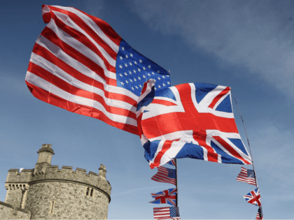 WINDSOR, ENGLAND - MAY 18: The national flags of Great Britain and the United States fly over a merchandise stall ahead of the royal wedding of Prince Harry and Meghan Markle on May 18, 2018 in Windsor, England. (Photo by Chris Jackson/Getty Images)
