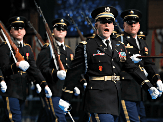 Members of the 3rd U.S. Infantry Regiment, The Old Guard, march past the viewing stands during a full honor arrival ceremony in honor of the 23rd Secretary of the Army, Mark Esper at Conmy Hall, Joint Base Myer-Henderson Hall, Va. Friday, Jan. 5, 2018.