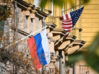 A Russian flag flies next to the US embassy building in Moscow on October 22, 2018. - US national security advisor John Bolton is in Moscow holding meetings with senior Russian officials following Washington's weekend announcement of withdrawal from the Cold War-era Intermediate-Range Nuclear Forces Treaty, known as the INF. …