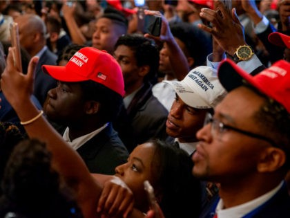 White House guests listen and take photographs as US President Donald Trump addresses the Young Black Leadership Summit at the White House on October 26, 2018 in Washington, DC. (Photo by Alex Edelman / AFP) (Photo credit should read ALEX EDELMAN/AFP/Getty Images)