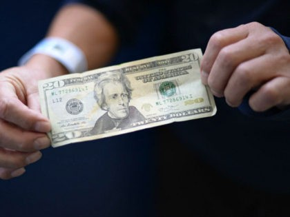 A member of a group of 228 immigrants deported from the United States shows a 20-dollar bill before exchanging it upon arrival at the Air Force base in Guatemala City on January 10, 2018. In 2017, the first year of the government of President Donald Trump, 32,833 Guatemalans were deported …
