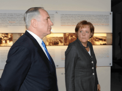 German Chancellor Angela Merkel (R) and Israeli Prime Minister Benjamin Netanyahu arrive at the underground Holocaust Memorial museum on January 18, 2010 in Berlin, Germany. Netanyahu and his delegation are in Berlin for a round of German-Israeli government consultations. (Photo by Moshe Milner GPO-Pool/Getty Images)
