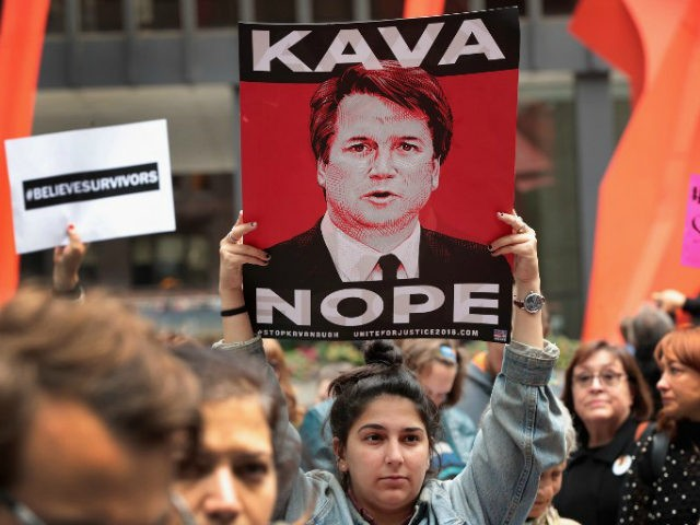 Activists and advocates for survivors of sexual abuse gather in the Federal Building Plaza to protest the confirmation of Supreme Court nominee Brett Kavanaugh on September 28, 2018 in Chicago, Illinois. Today the Senate Judiciary Committee voted out Supreme Court nominee Judge Brett Kavanaugh and agreed to an additional week …