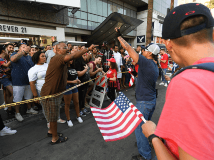 Trump supporters clash with anti-Trump crowd by the Trump Unity Bridge float parked by Trump star on the Walk of Fame in Hollywood on August 18, 2018. - The Trump Unity Float supporters met in Encino (15 miles NW of Hollywood) and caravaned on the 405 freeway, through some beach …