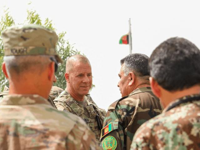U.S. Army Brig. Gen. Jeffrey Smiley, left, talks with Afghan Army Brig. Gen. Abdul Rahman Parwani on July 5, 2018. (Staff Sgt. Neysa Canfield)