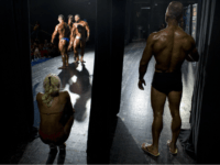 Dozens of glistening competitors took the stage for an annual body building and fitness competition in Tel Aviv last week. But behind the scenes, machismo made way for cooperation.
