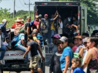 Trump warns Honduras to halt migrant 'caravan' or lose US aid