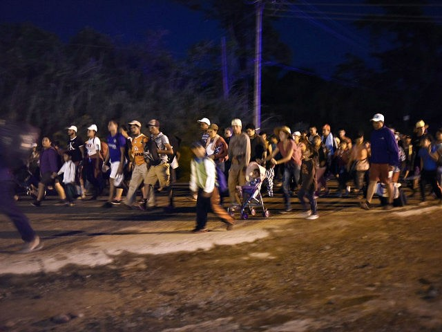 TOPSHOT - Honduran migrants taking part in a caravan heading to the US, walk in Huixtla, Chiapas state, Mexico, on October 24, 2018. - Thousands of mainly Honduran migrants heading to the United States, a caravan President Donald Trump has called an 'assault on our country', continued their march to …