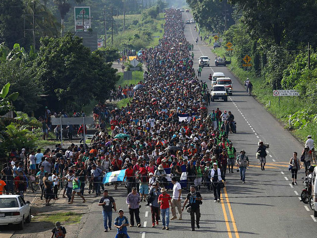 CIUDAD HIDALGO, MEXICO - OCTOBER 21: A migrant caravan, which has grown into the thousands, walks into the interior of Mexico after crossing the Guatemalan border on October 21, 2018 near Ciudad Hidalgo, Mexico The caravan of Central Americans plans to eventually reach the United States. U.S. President Donald Trump …