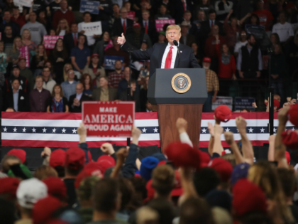 TOPEKA, KS - OCTOBER 06: U.S. President Donald Trump speaks to supporters during a rally at the Kansas Expocenter on October 6, 2018 in Topeka, Kansas. Trump scored a political victory today when Judge Brett Kavanaugh was confirmed by the Senate to become the next Supreme Court justice. (Photo by …