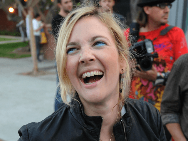 Actress Drew Barrymore laughs as she tries to pin on a 4 Equality badge during a Gay rights protest rally in Hollywood on May 26, 2009. California's Supreme Court upheld a referendum that outlawed gay marriage, but said 18,000 same-sex weddings carried out before the ban would remain valid. Gay …