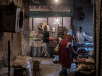 A picture taken on July 26, 2018, during an army-organised tour, shows Egyptians at the public market in el-Arish city in the northern Sinai Peninsula. - With fruit and vegetables aplenty in the markets, public transport back on the roads and universities reopened, life is returning to El-Arish in North …