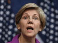 Sen. Elizabeth Warren (D-MA) delivers remarks during a news conference on the fifth anniversary of the Dodd-Frank Wall Street Reform and Consumer Protection Act at the U.S. Capitol Visitors Center July 21, 2015 in Washington, DC. Before being elected to the U.S. Senate, Warren helped craft the legislation that created …