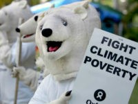 Oxfam activists wearing polar bear costumes stage a demonstration outside the venue of the U.N. climate change conference in Nusa Dua, Bali island, Indonesia, Thursday, Dec. 6, 2007. Developing nations at the U.N. Climate Change Conference demanded rapid transfers of technology to help them combat global warming, while a report …