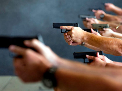 School teachers and administrators fire their guns during a three-day firearms course sponsored by FASTER Colorado at Flatrock Training Center in Commerce City, Colorado on June 27, 2018. - FASTER Colorado has been sponsoring firearms training to Colorado teachers and administrators since 2017. Over 100 Colorado teachers and administrators have …