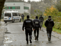 Policemen spread around the 'Centre Zahra France' religious association in Grande Synthe near Dunkirk early on October 2, 2018 during an operation of 'terrorism prevention'. - 3 people have been detained in police custody during the operation involving 200 policemen. (Photo by Philippe HUGUEN / AFP) (Photo credit should read …