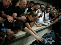 Relatives and friends mourn during the funeral of Kim Levengrond Yehezkel, aged 28, one of the two Israeli nationals killed earlier in an attack, on October 7, 2018, in Rosh Haayin, some thirty kilometers east of Tel Aviv. - A Palestinian shot dead two Israelis and wounded another at the …
