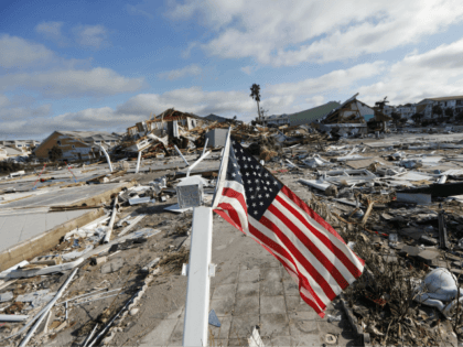 An American flag flies amidst destruction in the aftermath of Hurricane Michael in Mexico Beach, Fla., Thursday, Oct. 11, 2018. (AP Photo/Gerald Herbert)