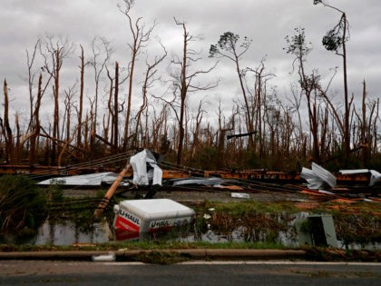 Shredded trees, derailed train cars and a sunken trailer are seen in the aftermath of Hurricane Michael in Panama City, Fla., Wednesday, Oct. 10, 2018. (AP Photo/Gerald Herbert)