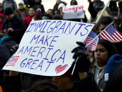 Supporters of immigrants' rights march in downtown Washington during an immigration protest Thursday, Feb. 16, 2017, in Washington. Immigrants around the U.S. stayed home from work and school Thursday to demonstrate how important they are to America's economy, and many businesses closed in solidarity, in a nationwide protest called A …