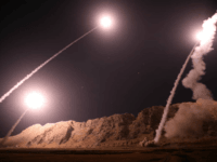 In this photo released on Monday, Oct. 1, 2018, by the Iranian Revolutionary Guard, missiles are fired from city of Kermanshah in western Iran targeting the Islamic State group in Syria. Iran's paramilitary Revolutionary Guard said Monday it launched ballistic missiles into eastern Syria targeting militants it blamed for a …