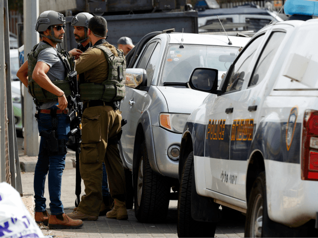 Israeli security forces gather at the site of a reported attack at the Barkan Industrial Park near the Israeli settlement of Ariel in the occupied West Bank on October 7, 2018. - A shooting attack by a Palestinian at an industrial zone for a West Bank settlement on Sunday killed …