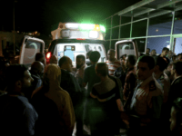 Residents and relatives of flood victims gather outside a hospital near the Dead Sea in Jordan Thursday, Oct. 25, 2018. Flash floods unleashed by heavy rains swept away a group of middle school students and teachers visiting hot springs near the Dead Sea on Thursday, killing people as the torrent …